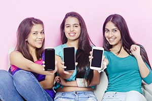 Teenage Girls Showing Phone