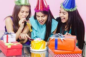 Teenager Cutting Birthday Cake