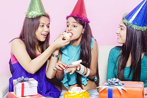 Friends Feeding Cake Birthday Girl