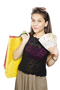 Young woman Shopping Bags Money