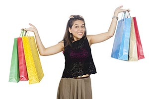 Young woman Shopping Showing Bags