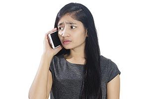 Sad Business Girl Talking Phone