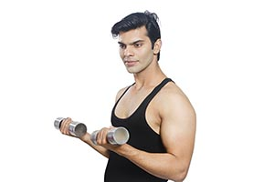 Portrait Indian Man Exercising Hand weights