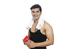 Handsome Fitness Man Holding Bottle Water