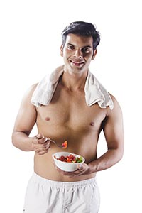 Indian Fitness Man Eating Fresh Salad