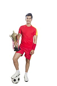 Man Football Player Holding Trophy Triumphantly