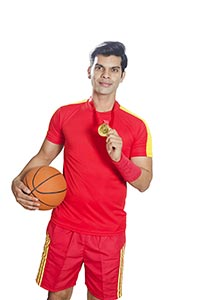 Basketball Player Holding Ball Showing Medal Victo