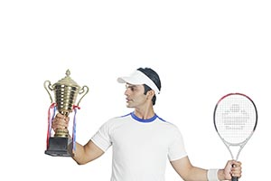 Man Tennis Player Holding Winners Trophy