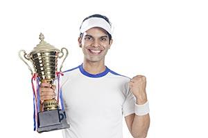 Tennis Player Celebrates Championship Trophy