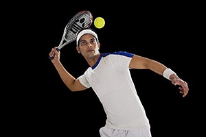 Indian Male Tennis Player Hitting Ball