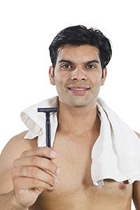 Man Clean Shave Showing Razor