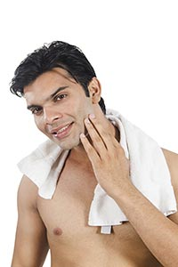 Smart Man Cleaning Face After Shave