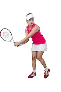 Woman Playing Tennis Hitting Ball�