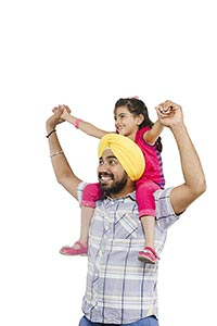 Indian Father Carrying Daughter Shoulders