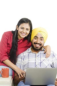 Indian Couple Using Laptop