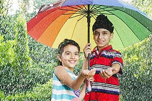 Indian Kids Under Umbrella Rainfall