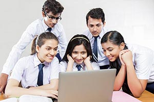 Group School Students Watching Laptop
