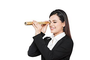 Businesswoman LookingThrough Telescope