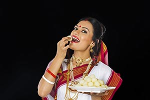 Bengali Woman Sweets Eating