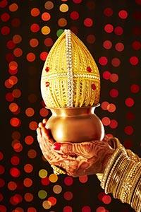 Indian Bride Grihapravesh Holding kalash