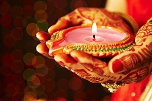 Close-up Indian Bride Hands Holding Diya Light