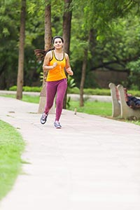 Sporty Woman Running Outdoors Park