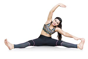 Fit Woman Stretching Body Sitting Floor
