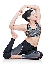 Woman Doing Yoga Rajakapotasana