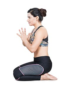 Indian Female Practising Yoga kneeling