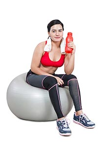 Woman Sitting Gymball Holding Water Bottle