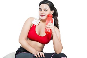 Fitness Woman Sitting Holding Water Bottle
