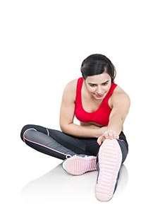 Fitness Woman Sitting Stretching