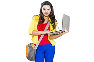 Female College Student Standing Using Laptop