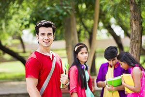 Teenager College Boy standing in the park
