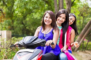Girls Riding Scooty