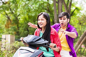 Teenagers Couple Riding Scooty