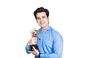 Rural Student Showing Trophy
