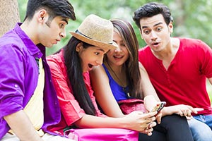 Friends Chatting Cell Phone