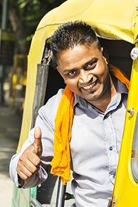 Happy Indian Auto Rickshaw Driver Thumbs up