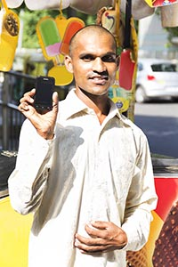 Icecream Vendor Indian Man Showing Phone