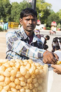 Street Vendor Man Giving Golgappe Customer