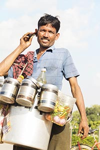 Man Vendor Selling Bhelpuri Talking Cellphone