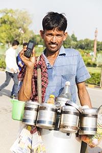 Man Vendor Selling Bhelpuri Showing Phone