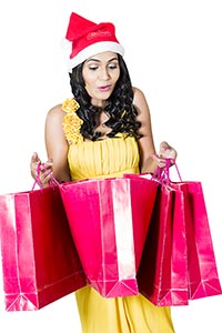 Christmas Girl Opening Shopping Bags