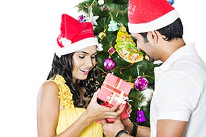 Couple Opening Christmas Presents