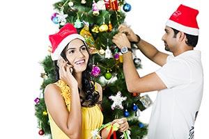 Couple Christmas Tree Decorating
