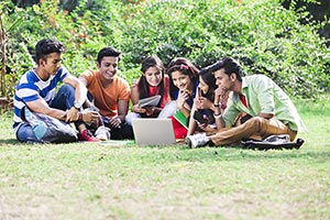 Indian College Friends Laptop Studying Together