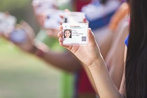 Teenage Girl Showing Aadhaar cards Focus On Foregr