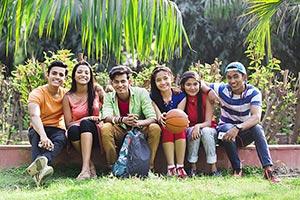 Group College Teenage Friends Sitting Park