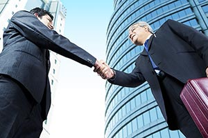 Businessman Colleague Making Handshake Partner Off